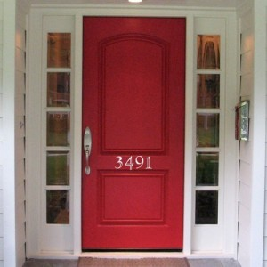 White Decal Numbers on red door